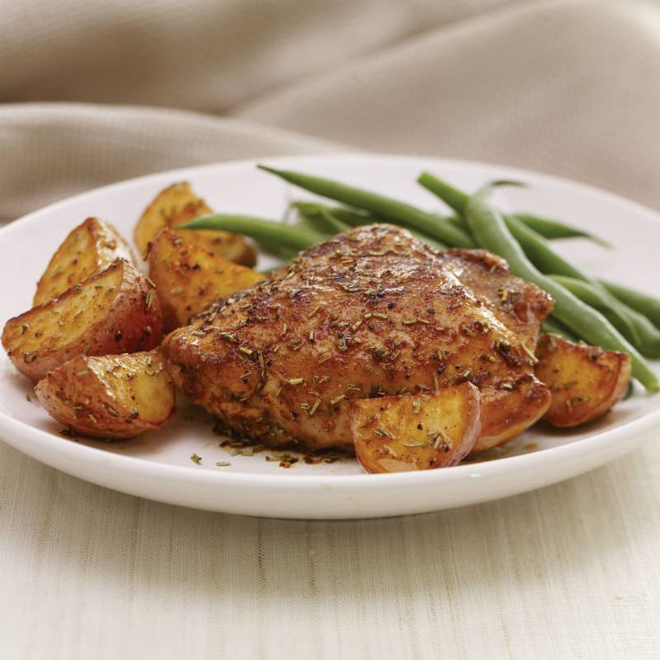 Roasted chicken and potatoes are perfected seasoned with aromatic rosemary, paprika and minced garlic.