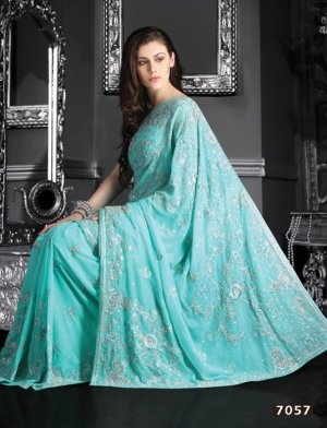 Light Blue Color Faux Shimmer Georgette Saree.  Saree is crafted with sequins, resham, stone, zari, cutdana work.  Fabric - Faux Shimmer Georgette.  Color - Light Blue.  Length of sarees with attached blouse pc. is 6.25 mtrs.  Costume/Outfit - Saree with Blouse piece.      #Online_sarees #Indian_sarees #Designer_sarees