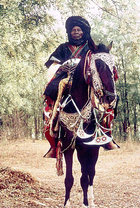 Africa | Man and Horse in Festive Dress for Sallah (Eid el Kabir) Celebration. Katsina, Nigeria.  1965 | ©Digital Library University of Wisconsin--Madison. African Studies Program. Photographer Jeanne Tabachnick