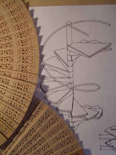 """Spiral """"wrought iron"""" staircase made with wood hand fan tutorial..Looks fairly easy to do"""