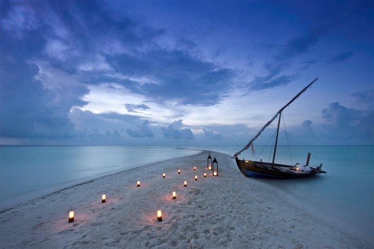 Kuramathi Island Resort in the Maldives. A sandbank, all dressed up for romance. Resort exclusive to Kuoni in the UK.