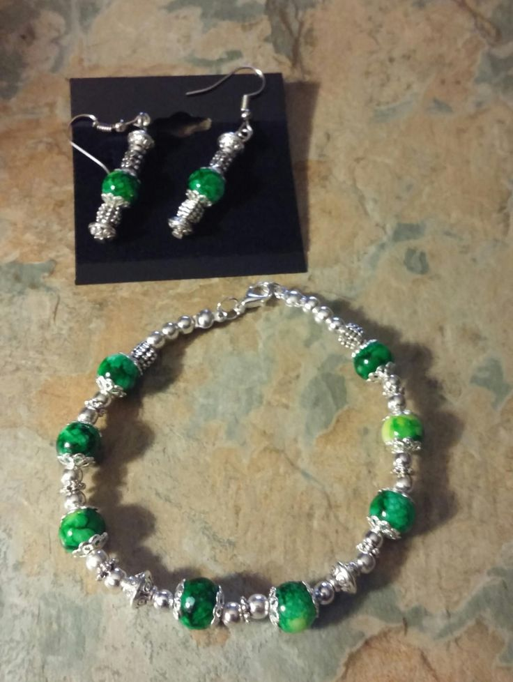 Green marble glass bead and silver handmade bracelet with matching earrings by SpryHandcrafted on Etsy