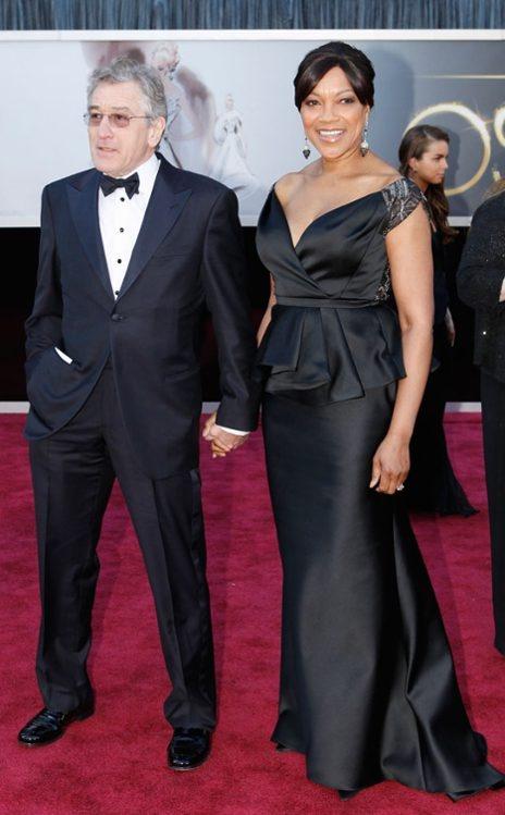 Robert De Niro & wife Grace Hightower, at the 2013 Oscars. In Giorgio Armani (De Niro). Lovely power couple.
