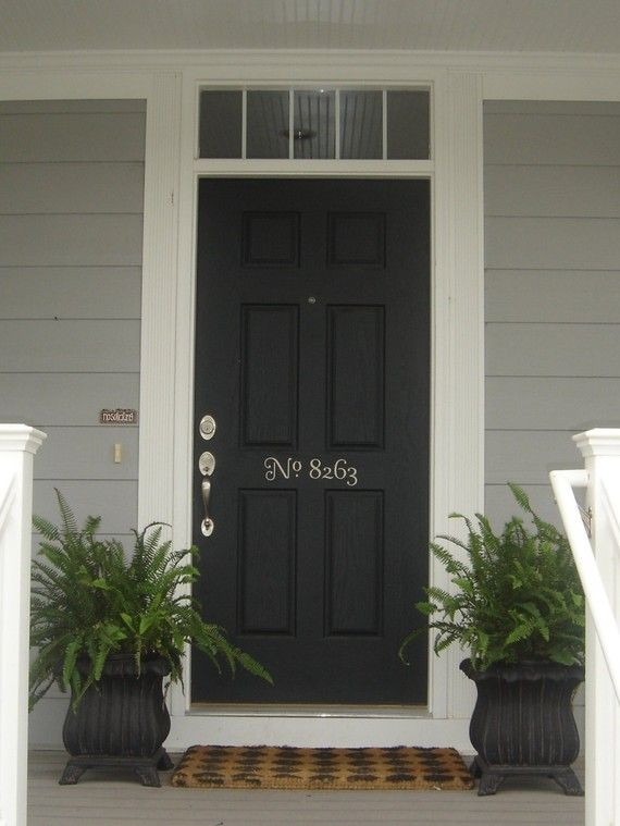 front door decor. I really want a black front door. The ferns are great.