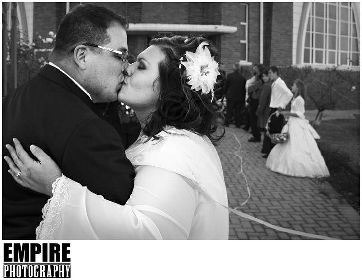 Wedding day kiss outside church