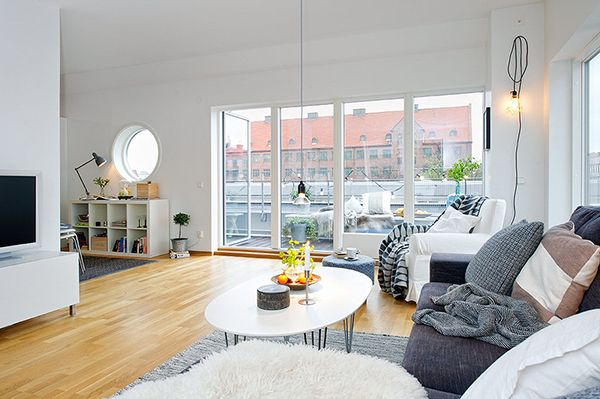 Set in Gothenburg, this particular apartment uses the typical Nordic touch with a plain and simple white backdrop and wooden flooring along with dark décor to present an appealing contrast all around.