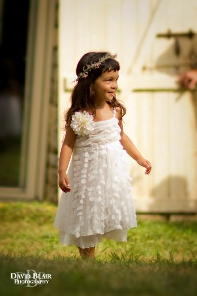 the cutest flower girl  by David Blair Photography / French Wedding Style Blog