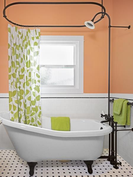 Classic black-and-white tile complements the vintage look of a claw-foot slipper tub in the master of this Craftsman bungalow. | Photo: Ken Gutmaker | thisoldhouse.com