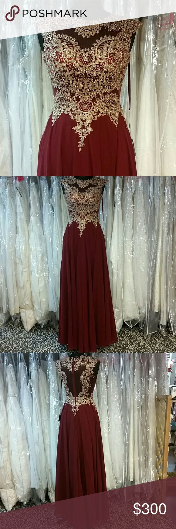 Burgundy/Wine and Gold Gown A dress created by the gods, gorgeous gold embroidered lace with AB crystals to give it shine on top of a burgundy red bodice and flowy chiffon skirt. Zipper back, illusion back (unlined and slightly stretchy), great for prom, homecoming, wedding, pageants, parties, or any formal event. Designer: Let's Fashion, size: small, color: burgundy/wine red. Sherri Hill for exposure. This dress will have you feeling like a queen. Sherri Hill Dresses