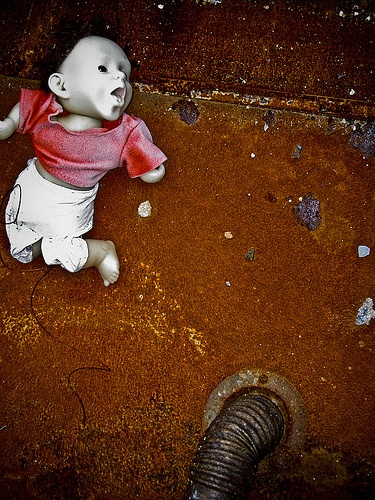 Doll and rust. Photo by Clare Gross, via Flickr.