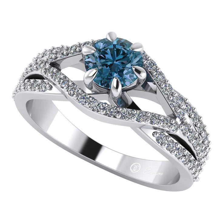 Inel din aur alb cu diamant albastru si diamante ES119