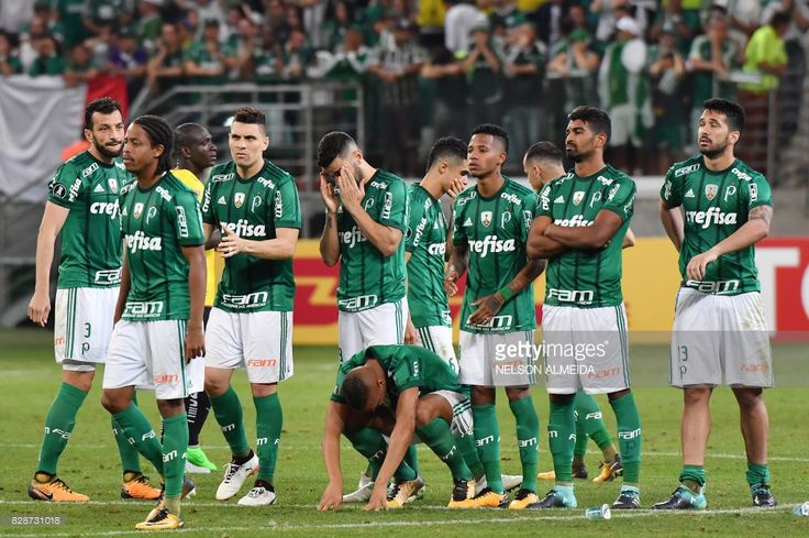 Brazil's Palmeiras footballers react after losing in a penalty shoot out against Ecuador's Barcelona in their 2017 Copa Libertadores football match held at Allianz Parque stadium, in Sao Paulo, Brazil, on August 9, 2017. /