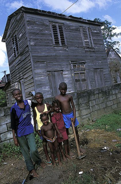 Children of Paramaribo, Suriname. in the background are the old wooden houses of freed slaves in Freemangro. Suriname, South America.