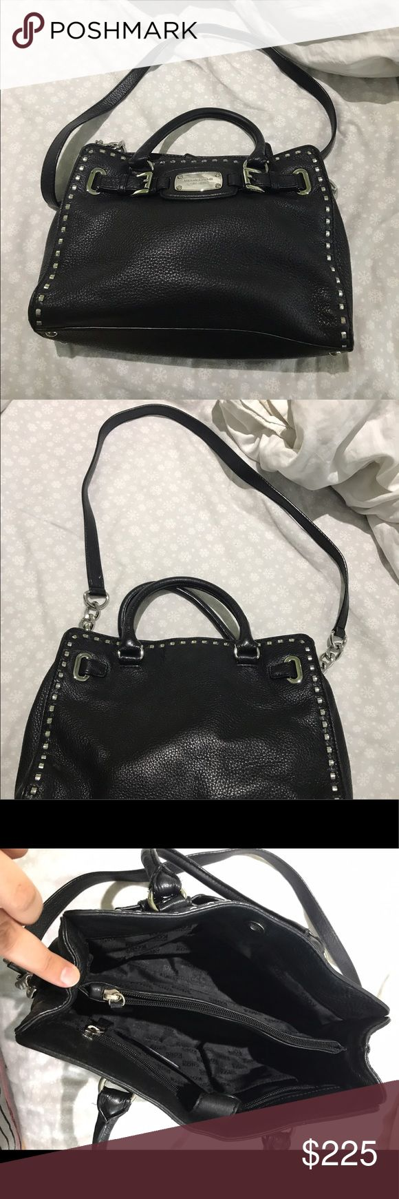 Michael Kors Black studied silver handbag purse In amazing condition and has some scratches due to wear. No rips! It is 9 in tall and 13 in in length. Comes with a extender strap or just use as a top handle. I paid $300 for it! Michael Kors Bags Shoulder Bags