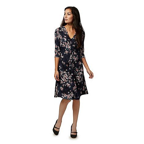 From our exclusive RJR.John Rocha range, this dress will introduce effortlessly feminine prints to a woman's evening wardrobe. Perfect for pairing with a simple clutch and pair of court shoes, it features a bold floral print, a feminine V neckline and a flattering gathered waist.