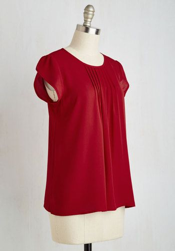 With your air of confidence and this rich red blouse, you'll engage your employees with awesome aplomb. Touting pintucked details below the neckline and tulip sleeves, this top nods to the graceful, business chic style that makes you one charismatic boss!