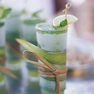 Blended Mojitos - A refreshing drink of lime, mint and rum, the mojito is the perfect cocktail for a summer evening. Here, it is blended, margarita style, and served in a tall glass with a sugared rim.