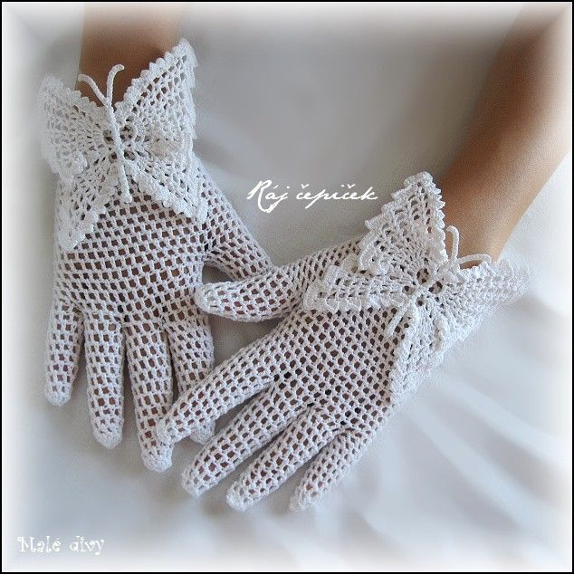Crocheted lace gloves on the wings of a butterfly