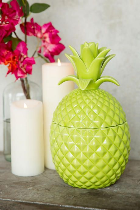 Add the Green Ceramic Pineapple Jar to any room in your home or apartment for fun tropical flair! This piece is perfect for summer season