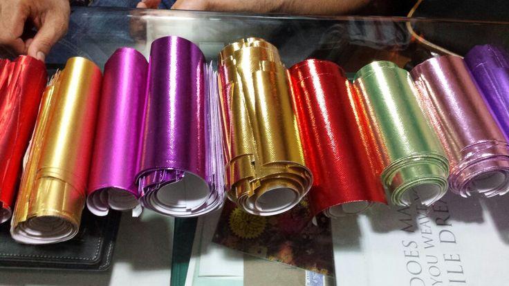 Metallic laminated non woven