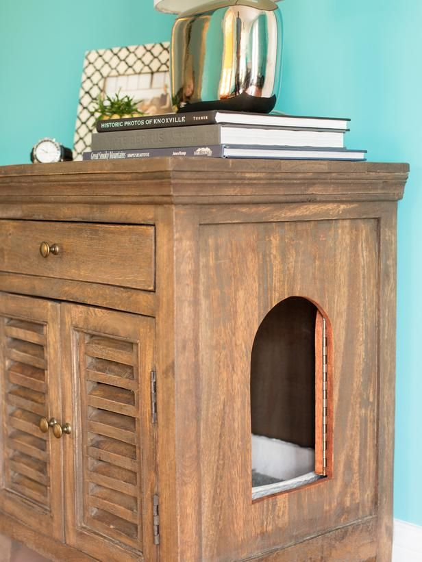 We've got to figure out how to keep the litter box in the bathroom, but I'd really like it to be less ugly!   How to Conceal a Litter Box in a Table : Decorating : Home & Garden Television