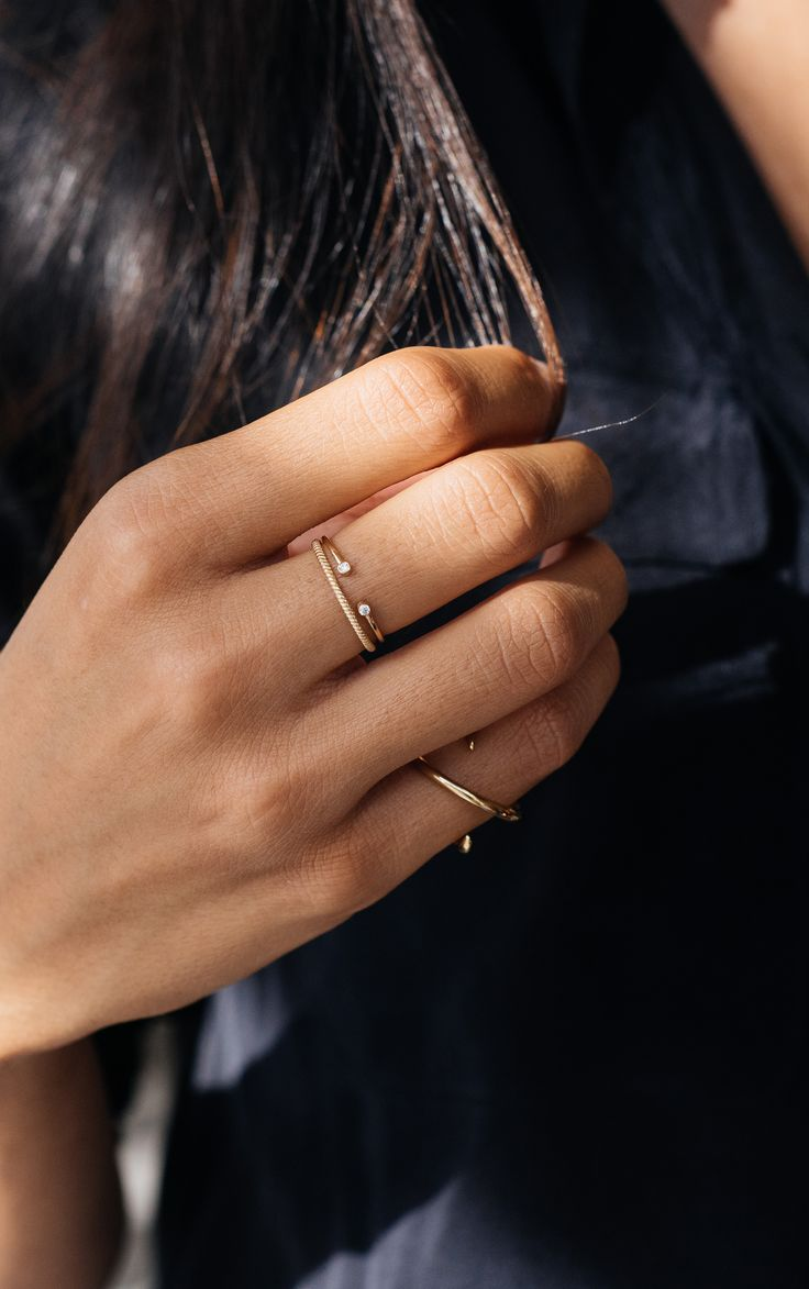 Oh so fine Mejuri stackable rings in 14K soid gold with diamonds.