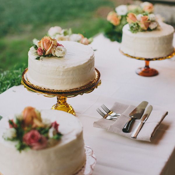 Cakes displayed on vintage glass cake stands.