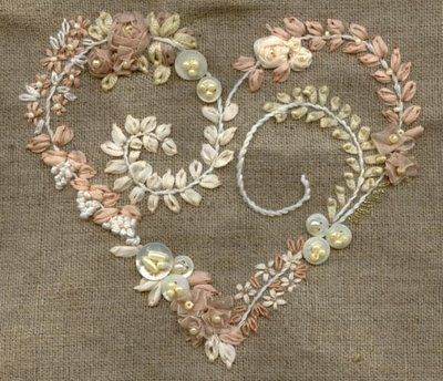 stitches and buttons and silk.I would love to do this project with some of my old pearl wedding buttons.