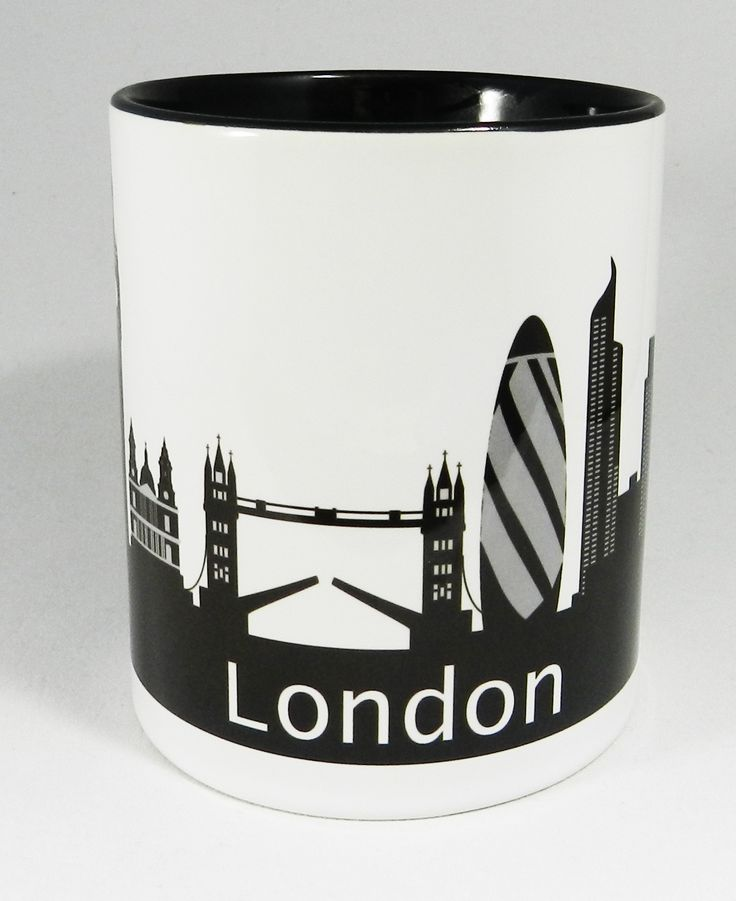 Iconic London Skyline Mug featuring The Houses of Parliament, Big Ben, St Pauls Cathedral, Tower Bridge, The Gerkin, Canary Whard and the London Eye. A high quality ceramic mug, with black handle and inner which is both dishwasher and microwave proof. Height 9.5cm Diameter 8.2 cm Capacity is 310ml (11oz). From the Series 1 Original Line Range by Half a Donkey Ltd. www.halfadonkey.co.uk