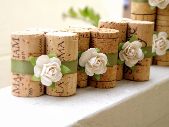 wine cork holders for place cards or food signs at a buffet. Available on Etsy, but these look simple enough for DIY.