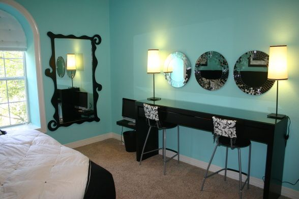 Tiffany Blue Teen bedroom, L-shape faux fur headboard, king size bedding, custom pillows.  Beauty bar with custom shaped mirrors and upholstered barstools., Girls Rooms Design