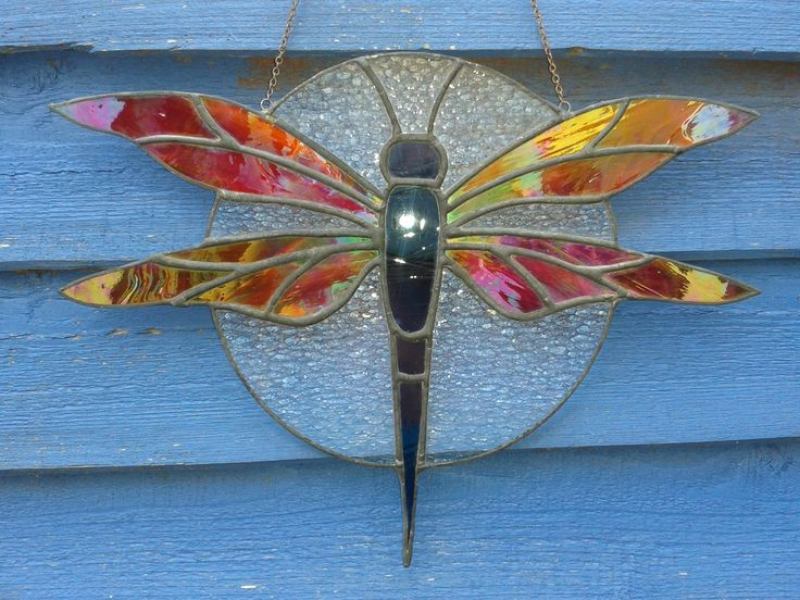 Red winged dragonfly. Copper foil window hanging made with iridescent glass and chain hung