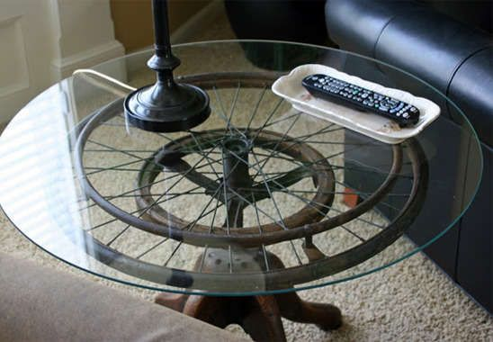 Industrial side table made from vintage wheelchair wheel