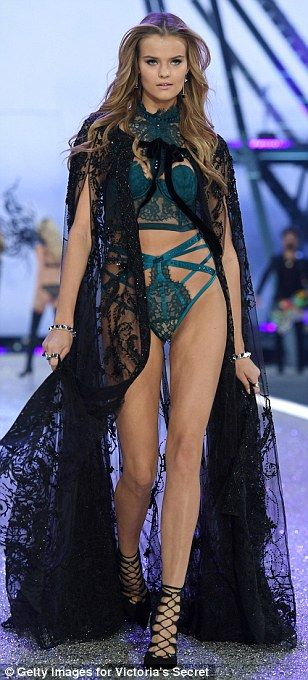Wow thing: Her stunning figure was shrouded with a beautiful lace cape...