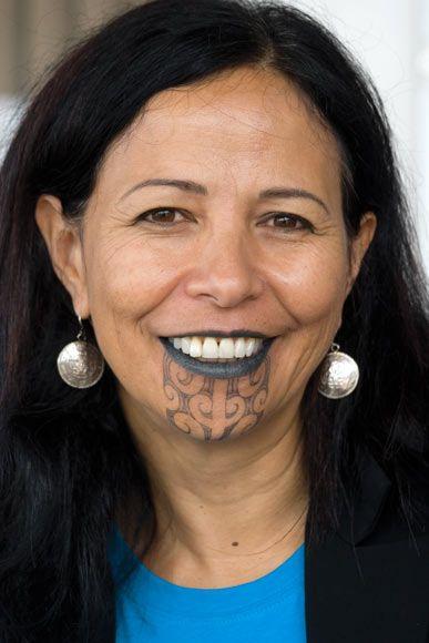 Judge Caren Fox (NgātiPorou, Rongowhakaata), deputy chief judge of the Waitangi Tribunal and a specialist in international human rights, wears the moko kauae (chin tattoo) and ngutu pūrua (fully tattooed lips).