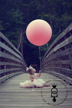 Good idea to have baby, toddler or young child hold balloon with number of their age or number of balloons they are old!