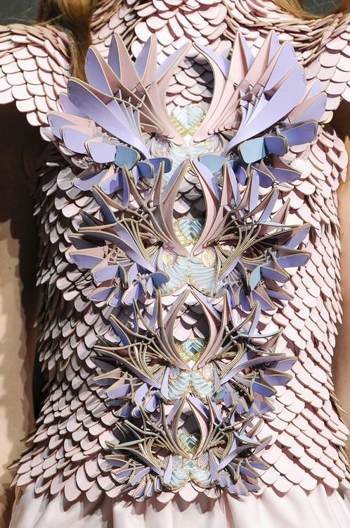 Scaly geometrical laser cut leather bodice. Manish Arora, SS13 RTW. Some amazing pieces in this collection.