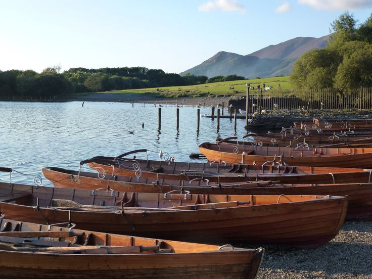Rowing boats on the shore of Derwent Water in the Lake District.