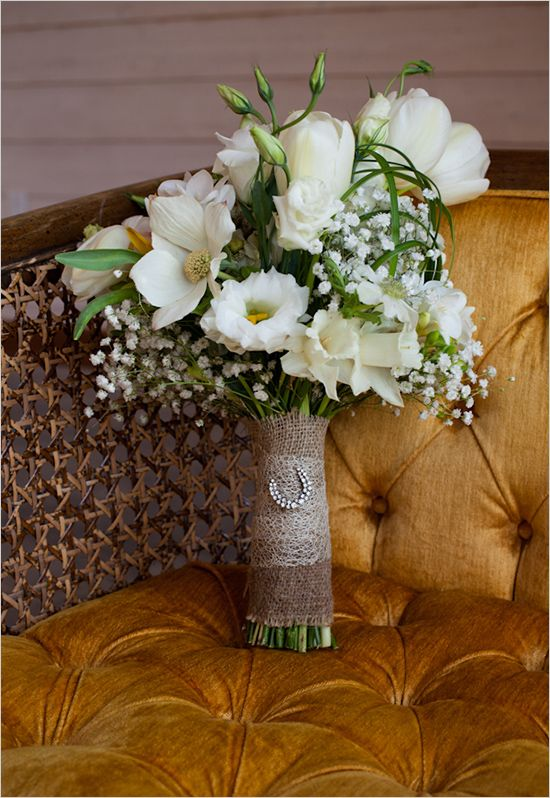 I like the idea of the flowers being wraped in burlap =)