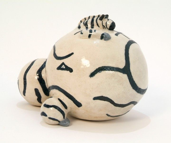 Ceramic fat zebra sculpture. As well as the style of horse which is like my Suffolk Punch Horse I also make horses, ponies and zebras in the same upright style as my cats and dogs. This sculpture was exhibited in the Intuitive Folk exhibition in 2014.