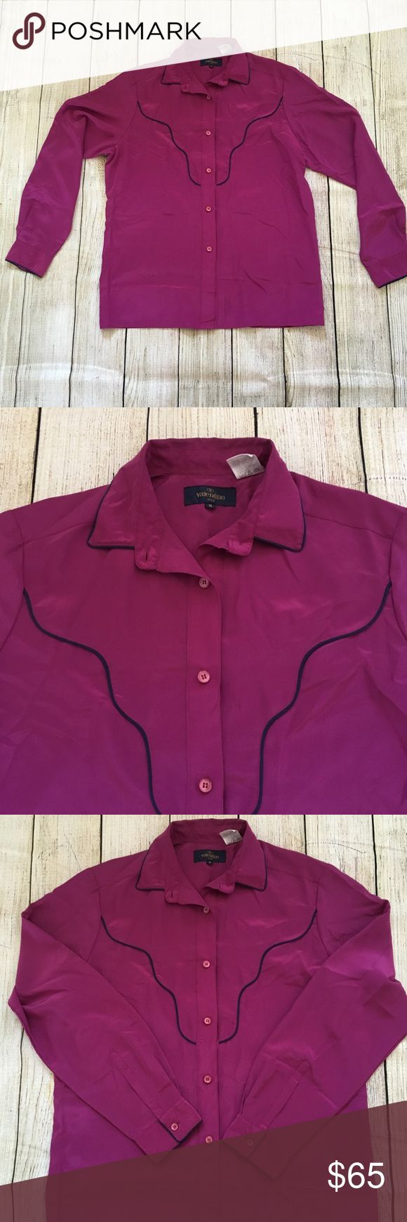 "Valentino Viva Women's M Fusia Button Down Shirt Valentino Viva Women's M Fusia Button Down Shirt. Deep Fusia Color with Navy Blue Piping - color is most similar to the 6th photo color. There's a dark spot on the bottom of the shirt near buttons but I don't think it's a stain; it looks like a manufacturer's error.   Measurements:  Sleeve length: 31"" (from center of back of collar, just below collar band, to end of cuff). Armpit-to-armpit: 20.5"". Chest (double the armpit-to-armpit): 41""…"