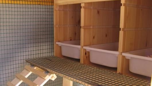 Urban chicken coop - using Ikea Trays for nesting boxes - easy to hose out if dirty