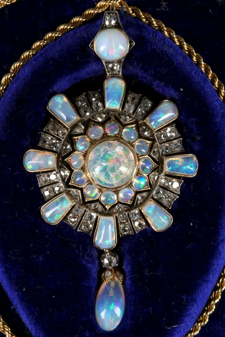 A fine Victorian gold, opal and diamond cluster pendant / brooch, with removable pin and gold rope twist chain, fitted box.