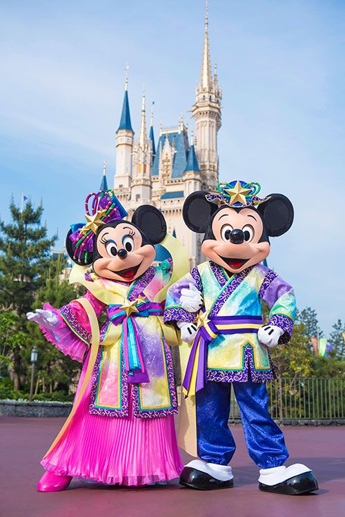 Mickey & Minnie Mouse sporting new overlay outfits nearby Cinderella Castle at Tokyo Disneyland Resort
