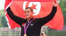 Swimming the 10K marathon for Tunisia, USC alumnus Ous Mellouli became the first Olympic gold winner from an Arab Spring country.