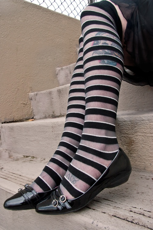 We're super excited about the ultra-classy sheer stripes in these OTKs from @tabbisocks! Shown on a tattooed leg so you can tell where the sheer bits are. #socks #otk #stripes #sheer UPDATE: we regret to inform you that this style has been discontinued and is no longer available.