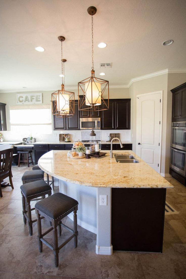 The unique curved kitchen island provides extra casual seating in the kitchen and also gives the large kitchen extra counter space, making meal prep simpler for this active family.