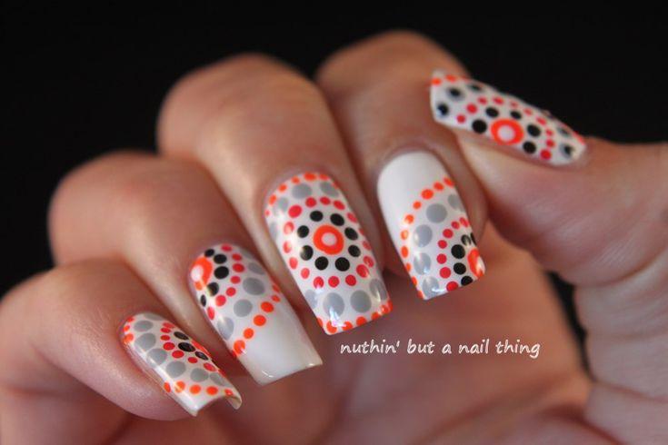 Tribal polka dot nail art