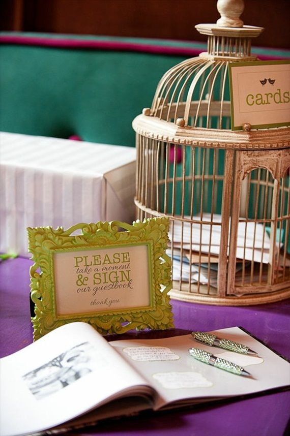 I like the bird cage (of course) with the cute little frames and card sign. A cute possible setup.