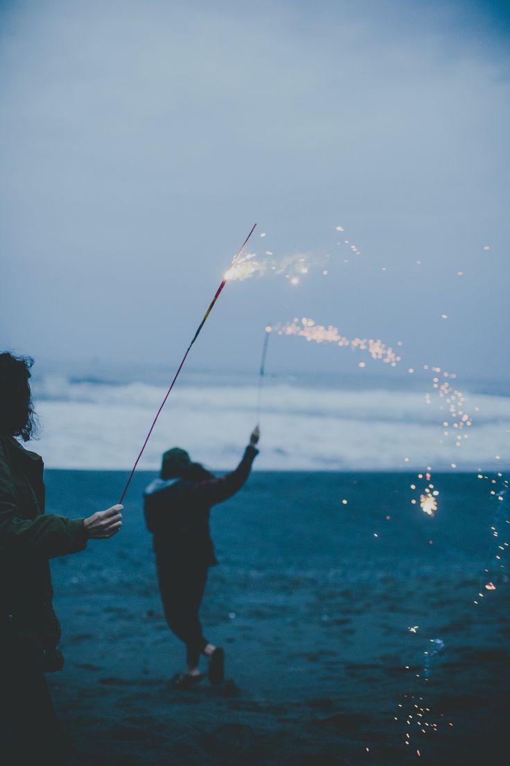 Sparklers on a Stormy Beach